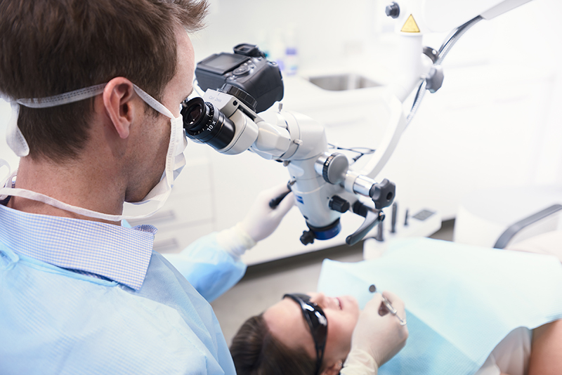 Registered Endodontist with Microscope
